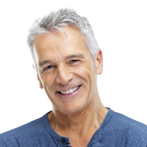 An older man smiles to show how dental implants from our Seattle practice can restore your smile.