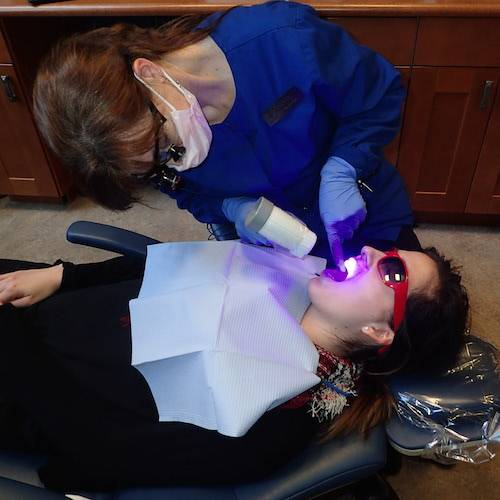 Seattle Family Dentistry - An actual patient of Dr. Curtis gets preventive dental treatments from our highly skilled staff.