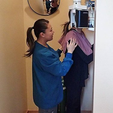 The staff at Downtown Dentistry takes digital X-Rays on one of our actual patients at our Seattle, WA dental practice.