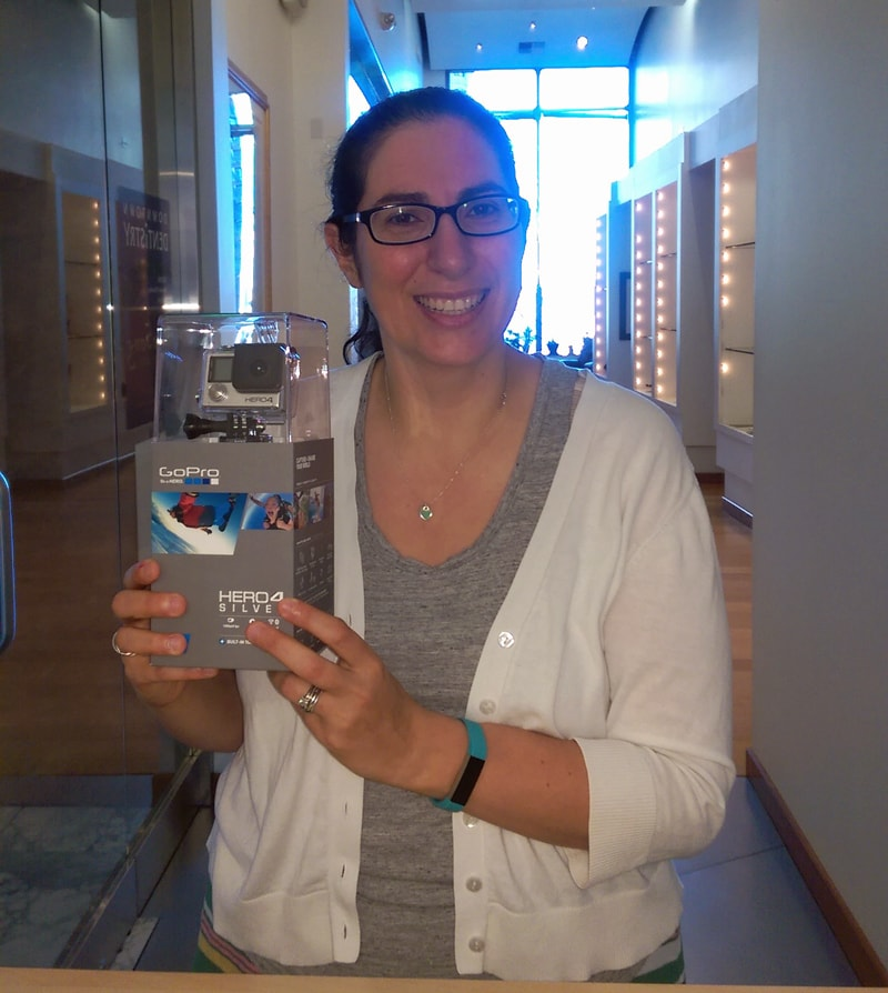 Sam K holding her GoPro first prize from our Scavenger Hunt.