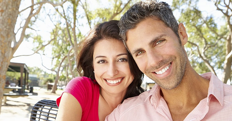 A couple smiling after getting dental veneers in Seattle